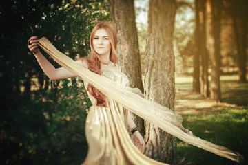 girl beauty in wood with tissue on wind