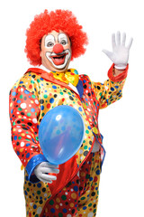 Portrait of a smiling clown with balloon isolated on white