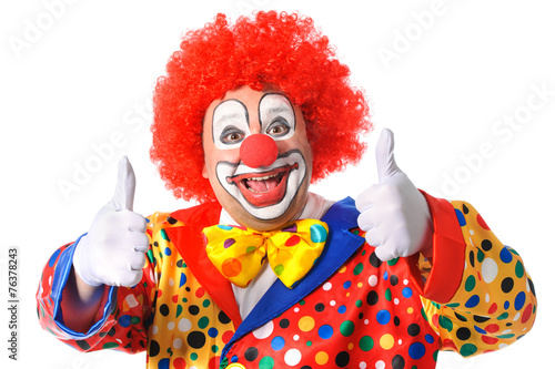 Leinwanddruck Bild Portrait of a smiling clown giving thumbs up isolated on white