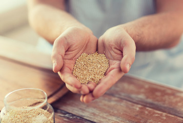 cloes up of male cupped hands with quinoa