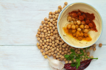 Hummus dish on a vintage wooden background