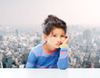 sad little girl over city background