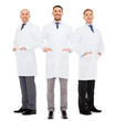 smiling male doctors in white coats