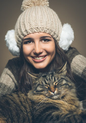 Beautiful woman with cat ( focus on cat)