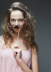 Girl wearing fake mustaches.
