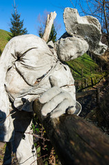 sculpture of a man in the mountain