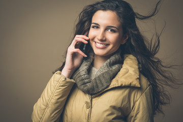 Smiling beautiful woman with mobile phone