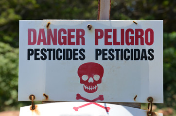 Danger Pesticides Peligro sign