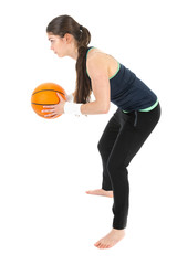 Pretty woman playing basketball, isolated over white