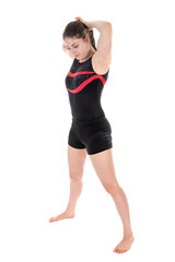 Young woman preparing a gymnastic exercise. isolated over white