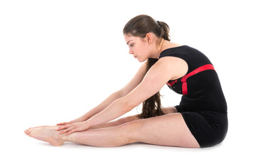 Young woman warming up for a gymnastic exercise