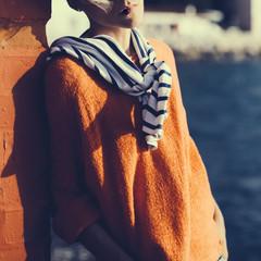 Stylish blonde on vacation. Travel. Marine style fashion