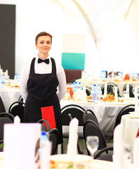 Waiters serving wine at a luxurious gathering.