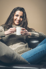 Smiling woman having a coffee