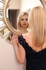 woman beside mirror