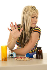 woman with lots of pills hand up look side