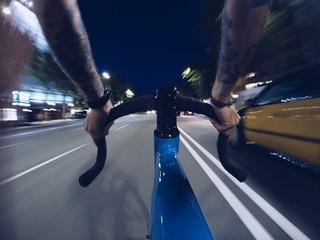 Fast biking on roads of night city
