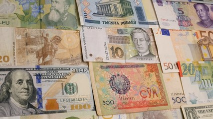 Various currency notes background. Dollar, Euro, Yuan, Lira, Ku