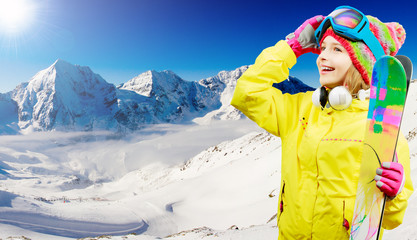 Skiing, freeski - girl enjoying ski vacation