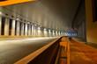 Leinwanddruck Bild - A fragment of the motorway tunnel footpath