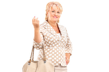 Blond mature woman posing with a purse bag