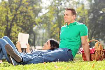 Couple having a picnic in park