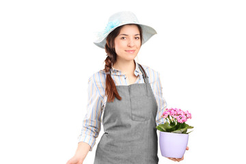 Female gardener holding a watering can