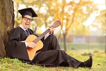 Graduate student playing acoustic guitar