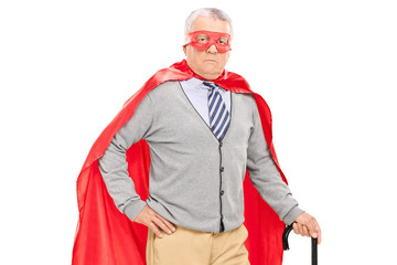 Senior superhero posing with a cane
