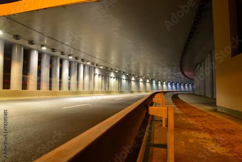 Leinwanddruck Bild A fragment of the motorway tunnel footpath