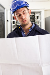 Smiling electrical designer at work