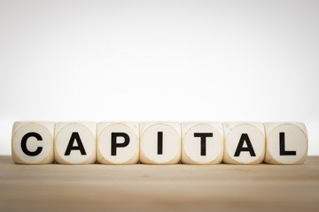 Capital spelled out with toy dice