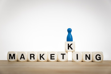 King pawn on the word Marketing