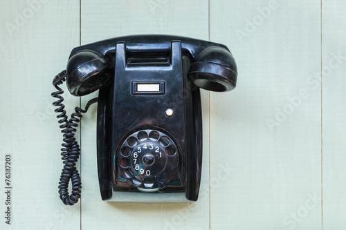 Leinwanddruck Bild Vintage black wall telephone