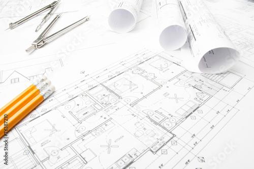 Zdjęcia na płótnie, fototapety, obrazy : Construction planning drawings rolled on the worktable