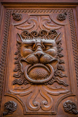 Decor old door in the form of a lion's head.