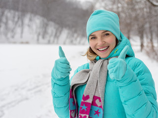 Young happy woman at the winter park.