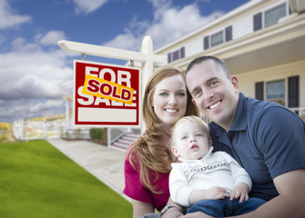 Young Military Family in Front of Sold Sign and House