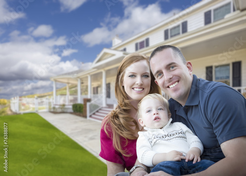 canvas print picture Young Military Family in Front of Beautiful House