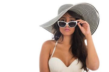 Portrait of black woman in white bikini with straw hat