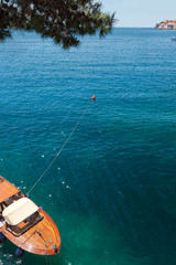 Aerial view on small boat tied to buoy