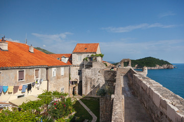 Old houses inside the city walls with Lokrum island