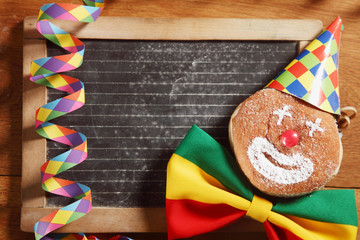 Decorated Carnival Donuts In Front Black Board