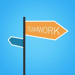 Teamwork nearby, orange road sign