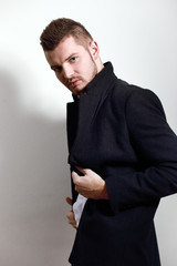 young man in coat