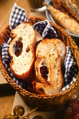 Fresh and toasted baguette in a bread basket
