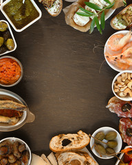 Assorted Tapas on Table with Copy Space at Center