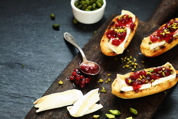 Gourmet sandwiches with camembert and cranberries