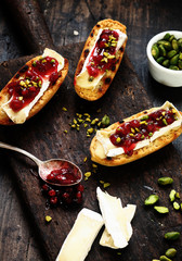 Tasty camembert and cranberries on toasted rolls