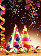 Party Hats and Streamers on Abstract Background